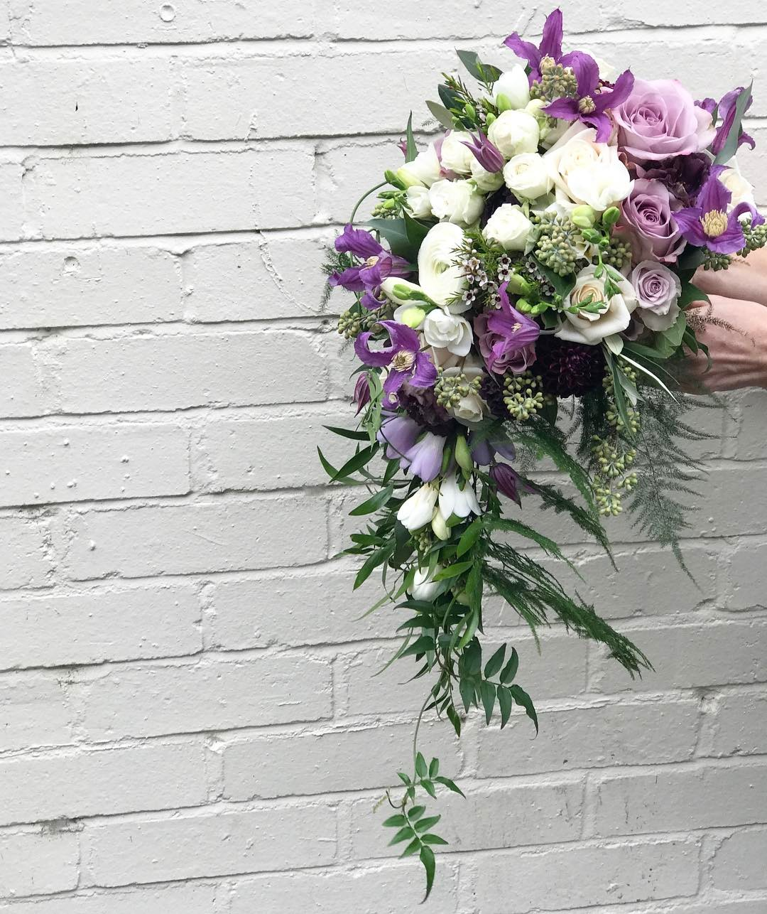 Cascading bouquet finished with a flurry of jasmine bridal cascading bouquet finished with a flurry of jasmine bridal weddingflowers bouquet izmirmasajfo